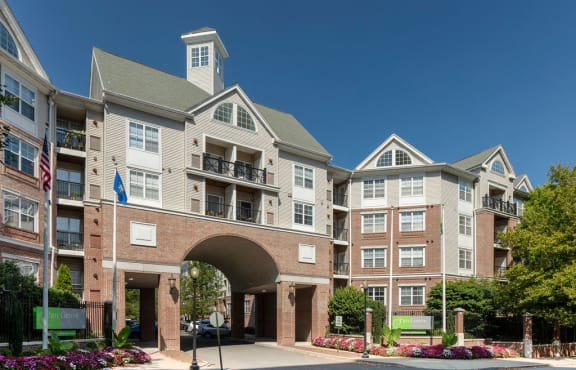Building exterior with the road passing under an archway at Sofi Parc Grove in Stamford, Connecticut