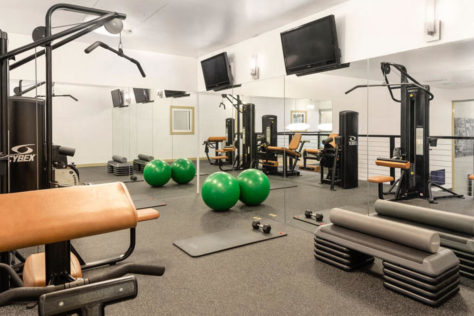 Spacious fitness center with a variety of equipment at Sofi Parc Grove in Stamford, Connecticut