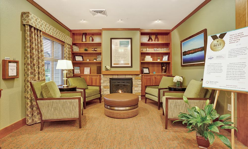 Small common area with fireplace at Seven Lakes Memory Care in Loveland, Colorado