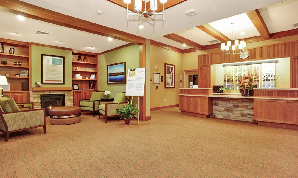 Help desk and waiting room at Seven Lakes Memory Care in Loveland, Colorado