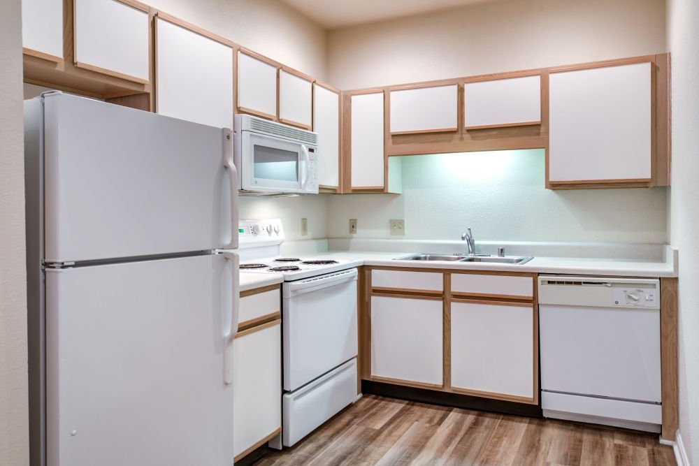 White appliances and hardwood flooring in an apartment home's kitchen at Renaissance St. Andrews in Louisville, Kentucky
