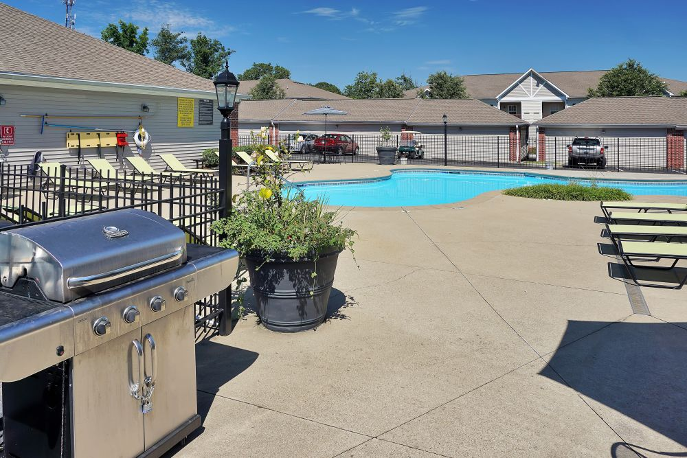 Barbecue area with gas grills near the pool at Renaissance St. Andrews in Louisville, Kentucky
