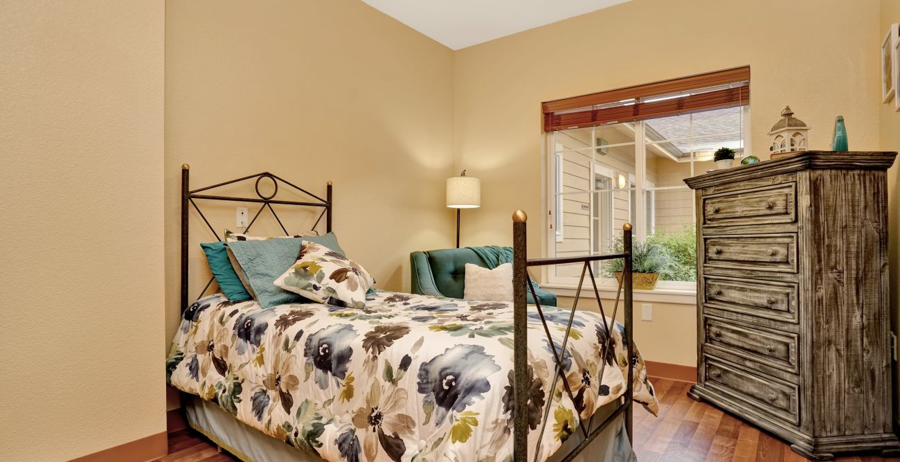 Furnished resident bedroom at Seven Lakes Memory Care in Loveland, Colorado