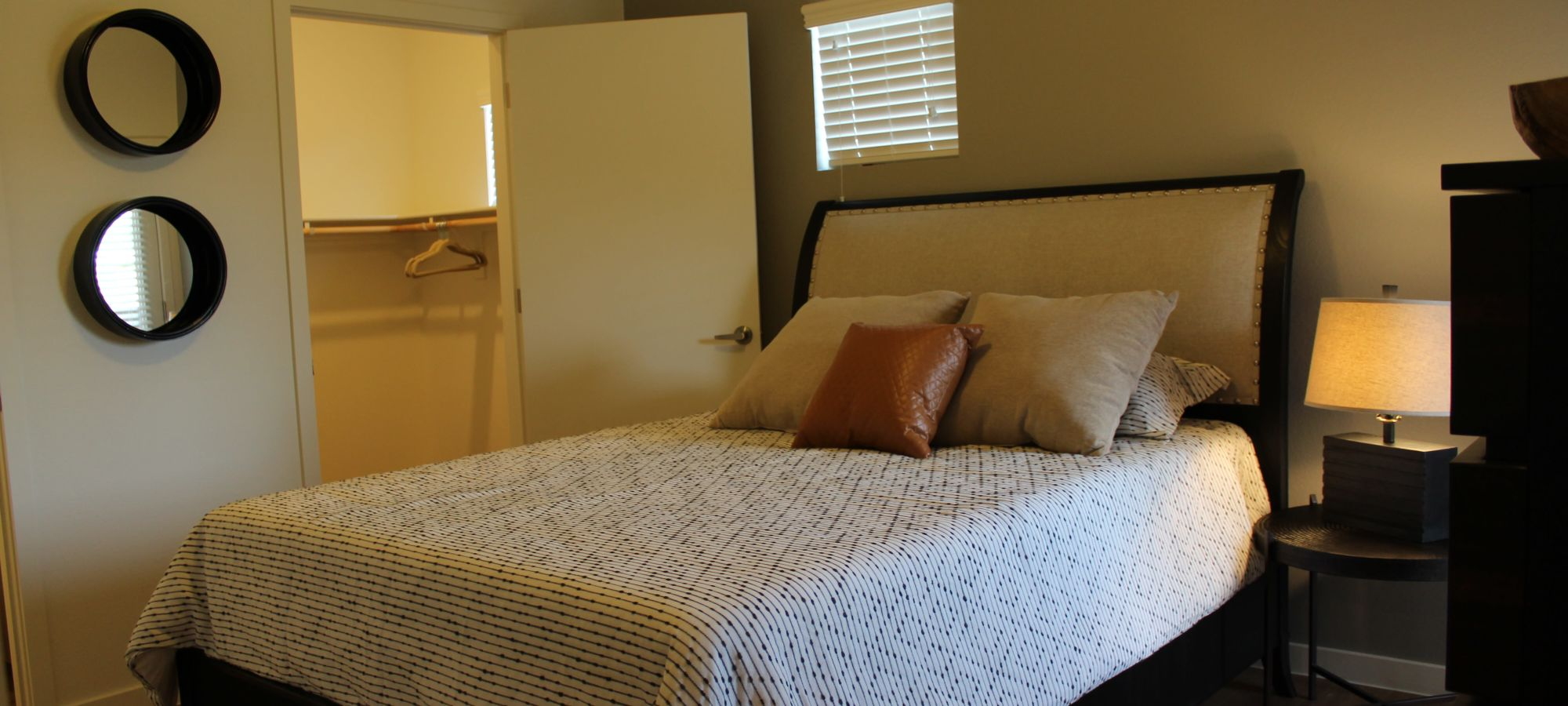 Master bedroom with walk-in closet at The Maxx 159 in Goodyear, Arizona