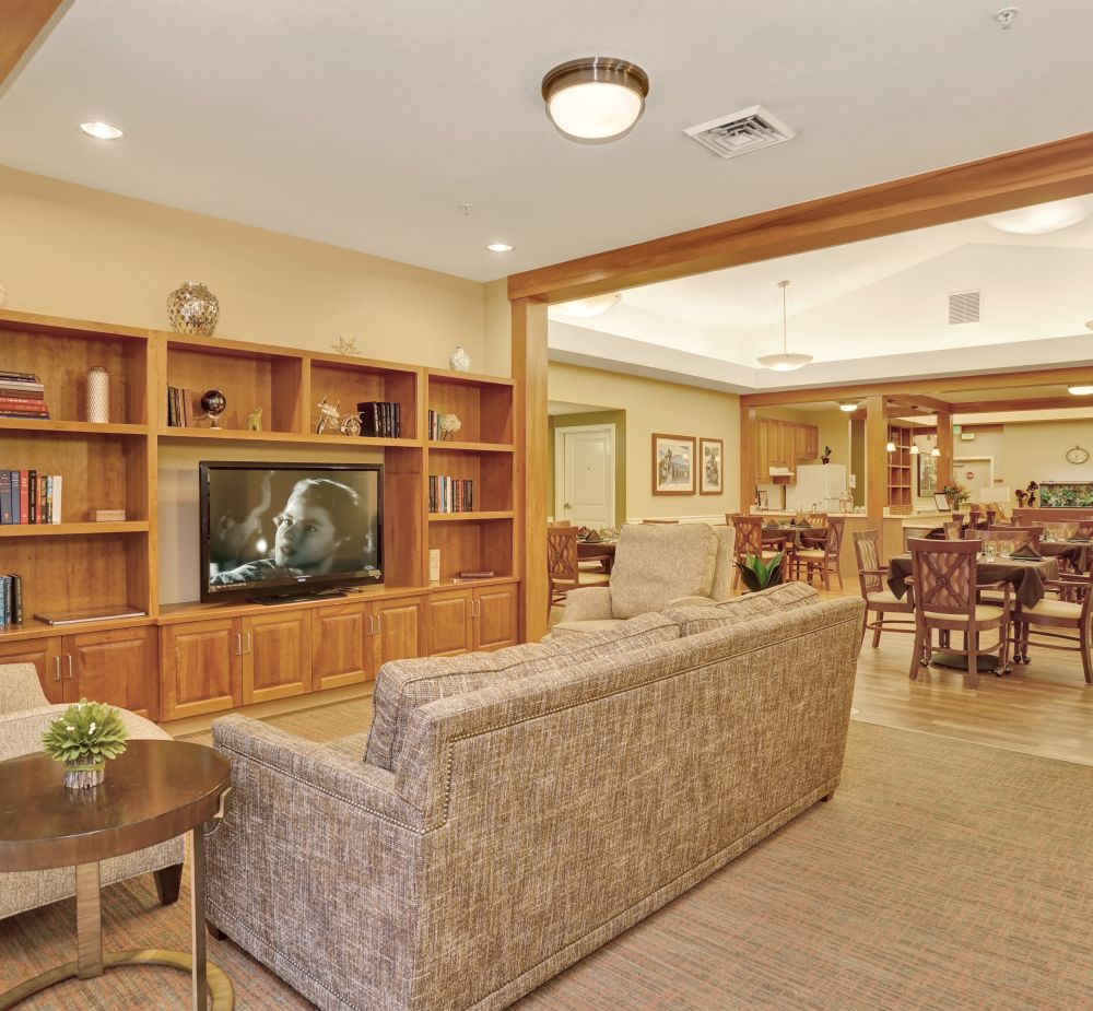 Common area with TV at Seven Lakes Memory Care in Loveland, Colorado