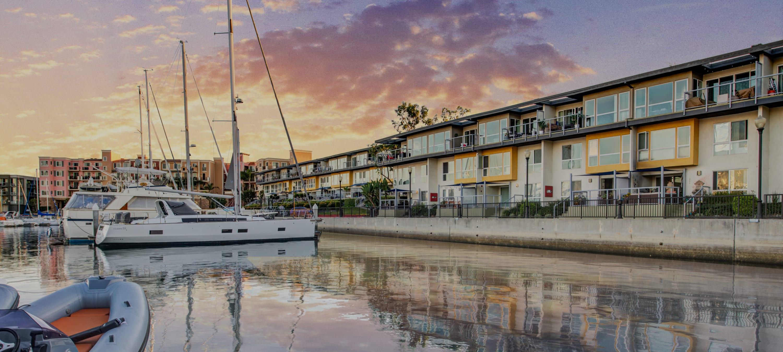 Beautiful sunset above the marina and The Tides waterfront apartments at Marina Harbor in Marina del Rey, California