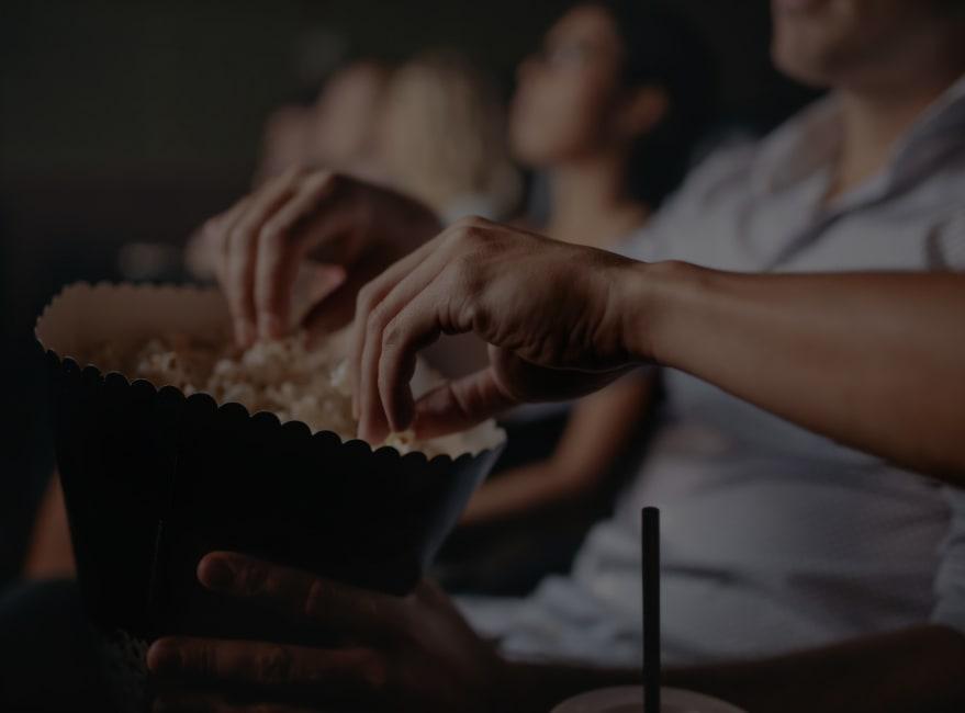 Residents eating popcorn at Regal Cinemas near Carvel Harbour Pointe in Mukilteo, Washington
