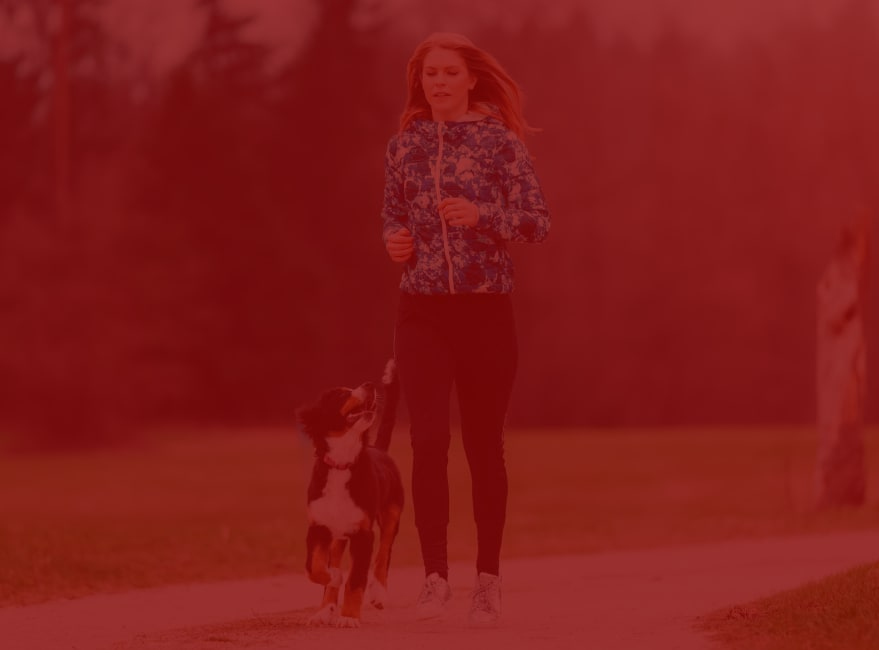 Resident running with her dog at Japanese Gulch Trail near Carvel Harbour Pointe in Mukilteo, Washington