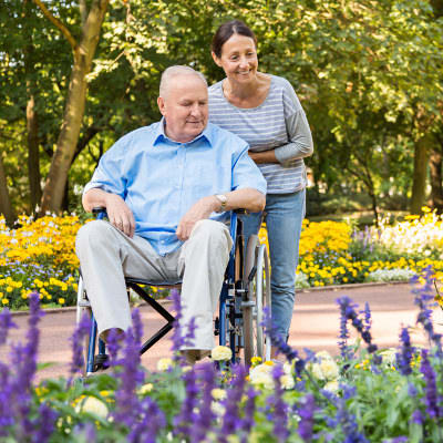 Canoe Brook Assisted Living & Memory Care resident enjoying a stroll in the garden