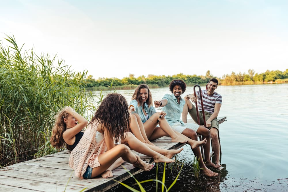 Residents relaxing on a dock near UNCOMMON Raleigh in Raleigh, North Carolina