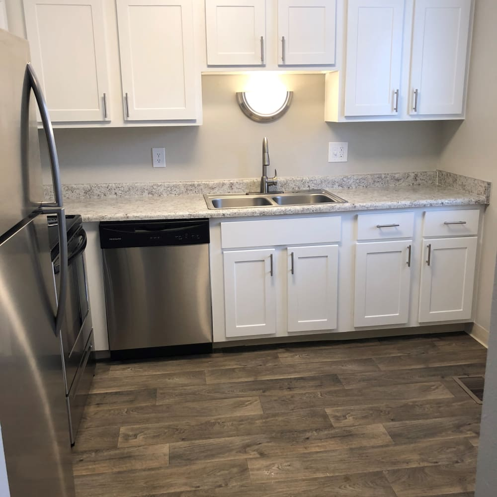 Updated kitchens with all new Stainless Steel appliances at Forest Cove Apartments in Denver, Colorado