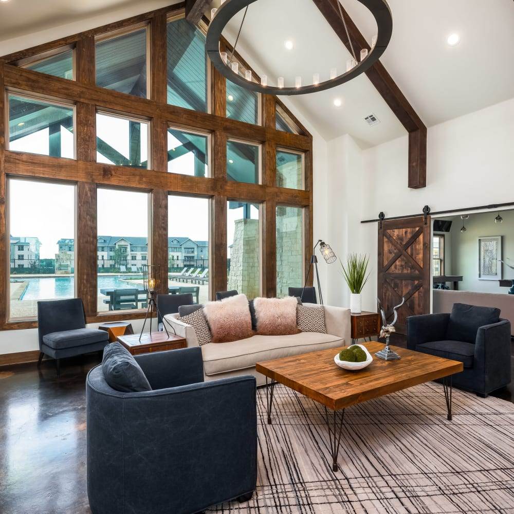 Comfortable seating and rustic architecture in the resident clubhouse at 4 Corners Apartments in Frisco, Texas