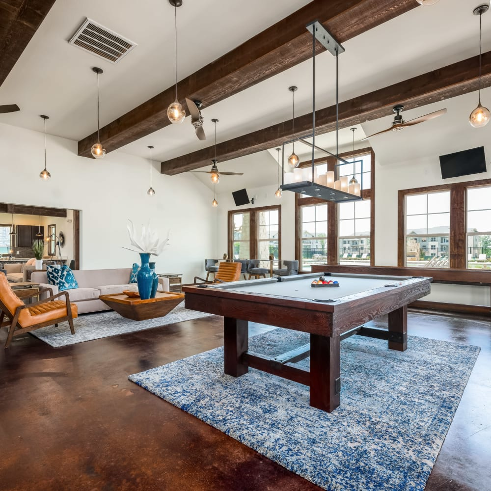 Billiards table and more in the clubhouse at 4 Corners Apartments in Frisco, Texas