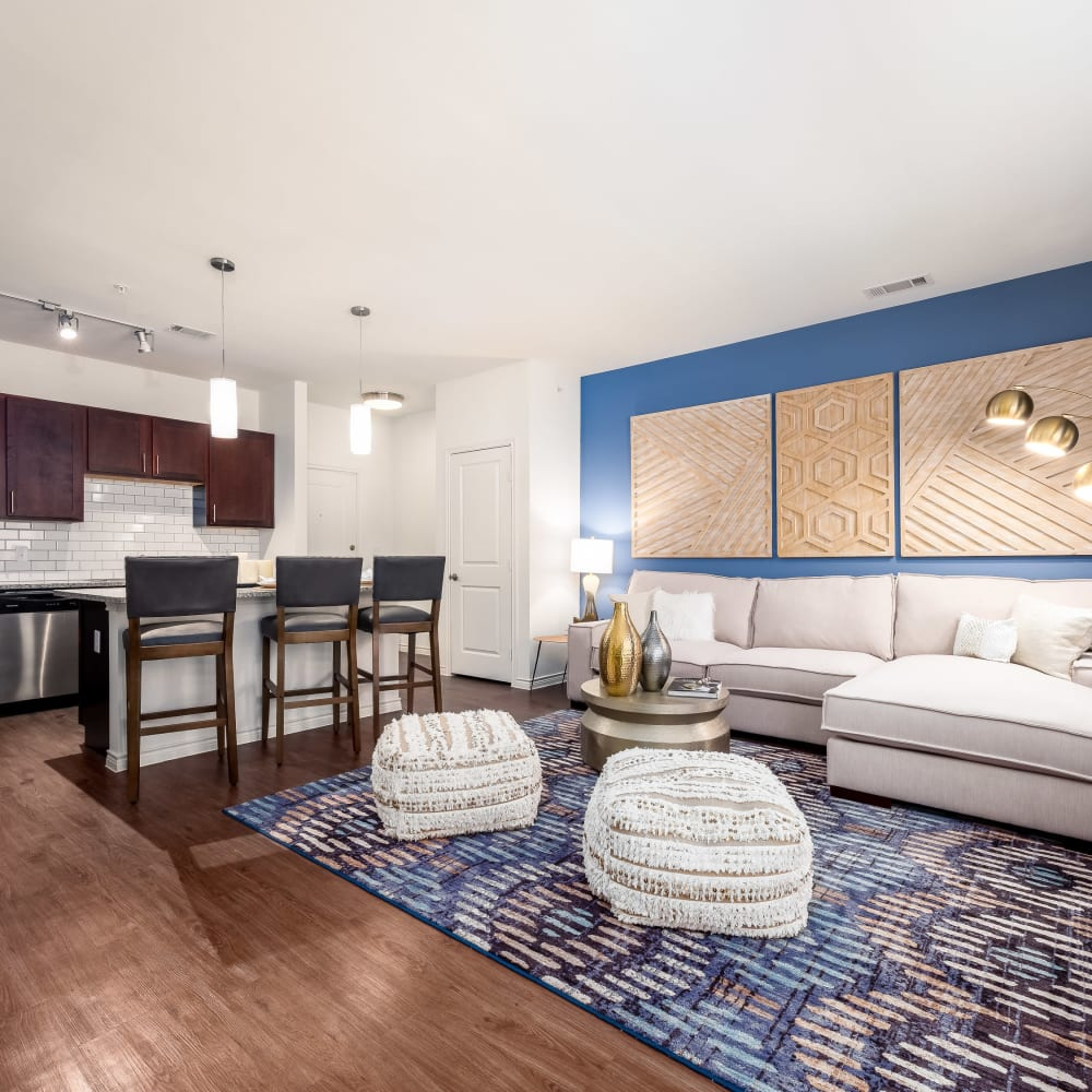 Accent wall and modern decor in model home's living area at 4 Corners Apartments in Frisco, Texas