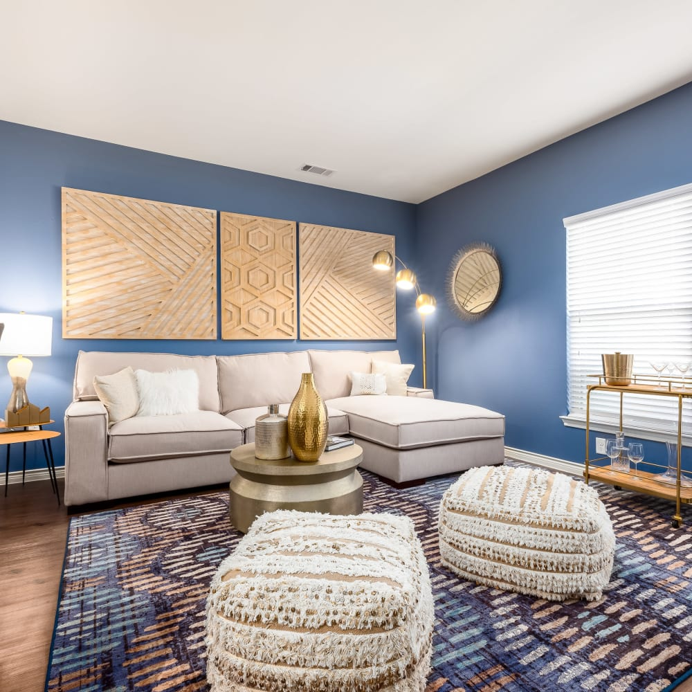 Well-decorated living space in model home at 4 Corners Apartments in Frisco, Texas