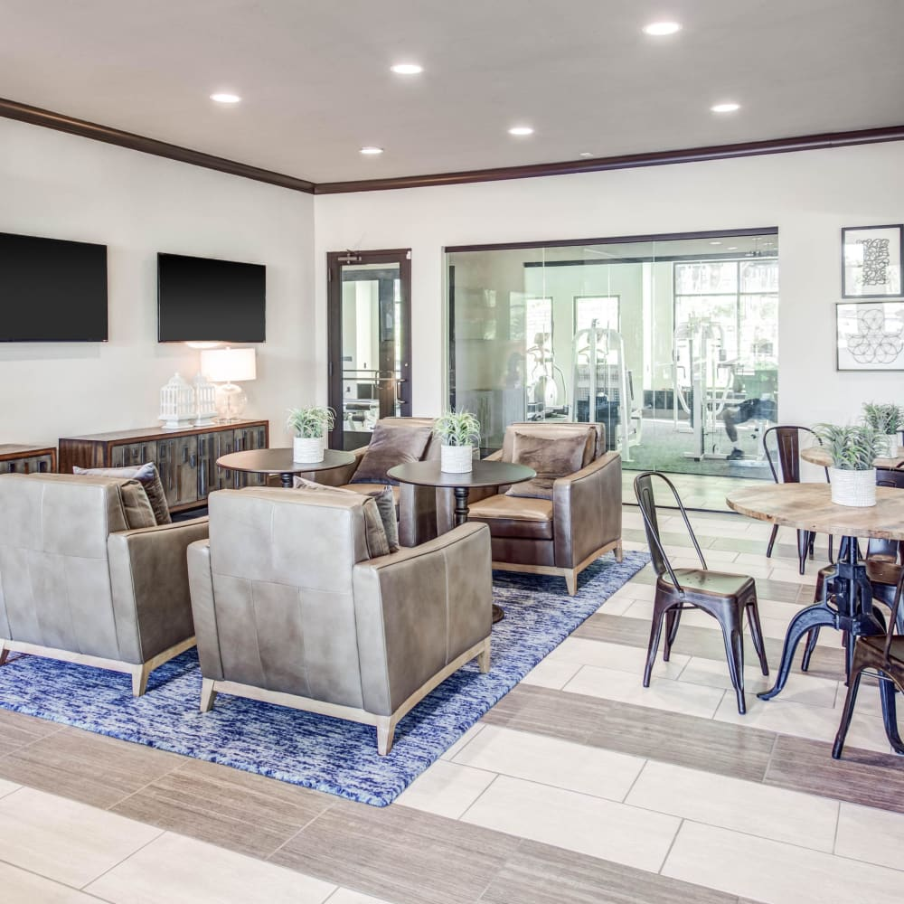 Comfortable seating and rustic architecture in the resident clubhouse at Beck at Wells Branch in Austin, Texas