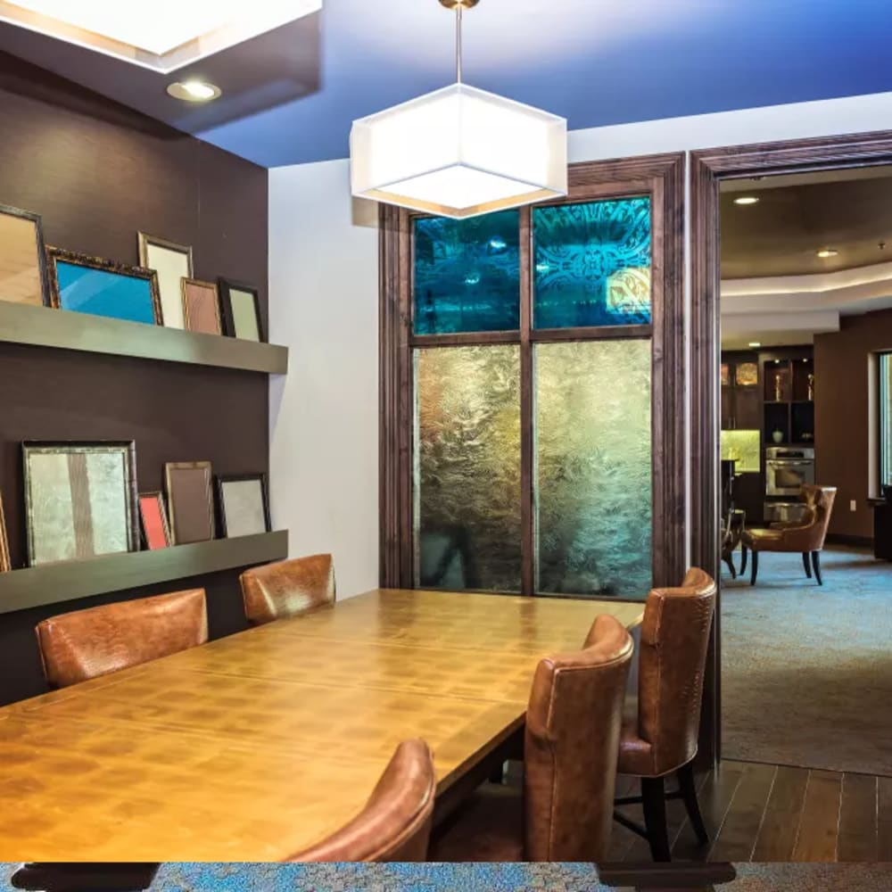 Private community conference room with leather seats and bright lighting at The Blvd in Irving, Texas