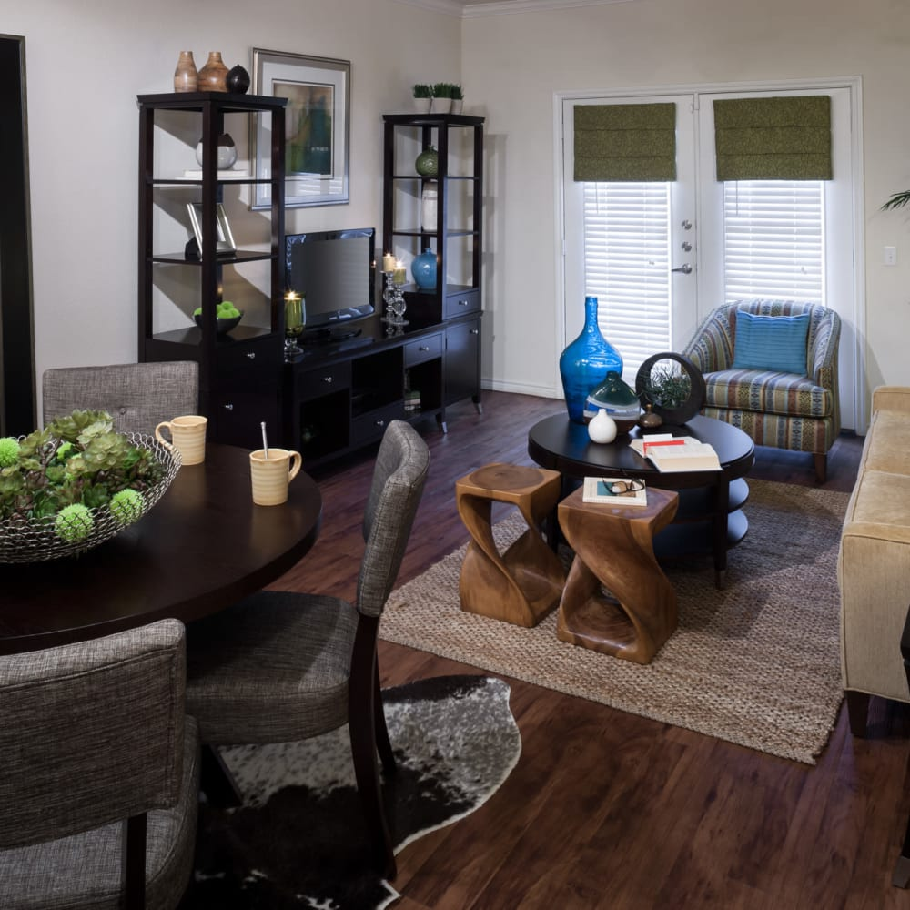 Living room with back patio access at The Asten at Ribelin Ranch in Austin, Texas
