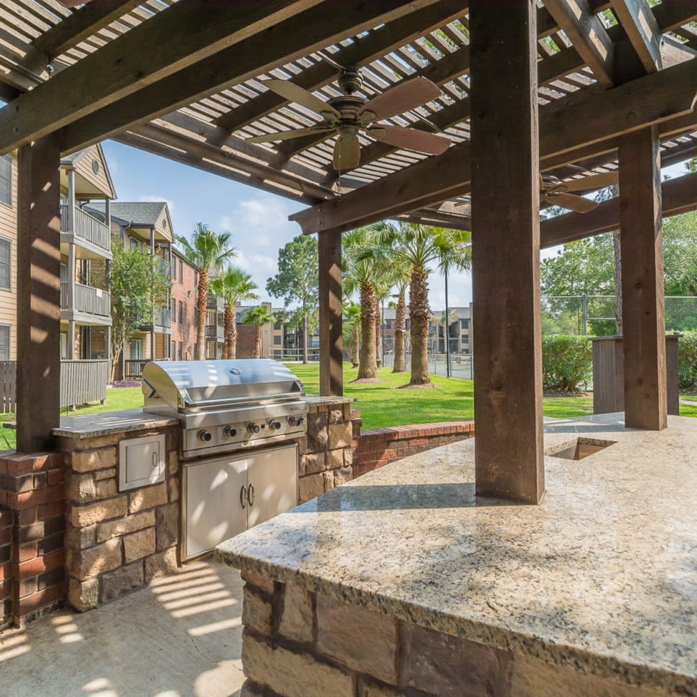 Covered outdoor grill with ceiling fans at Hayden at Enclave in Houston, Texas