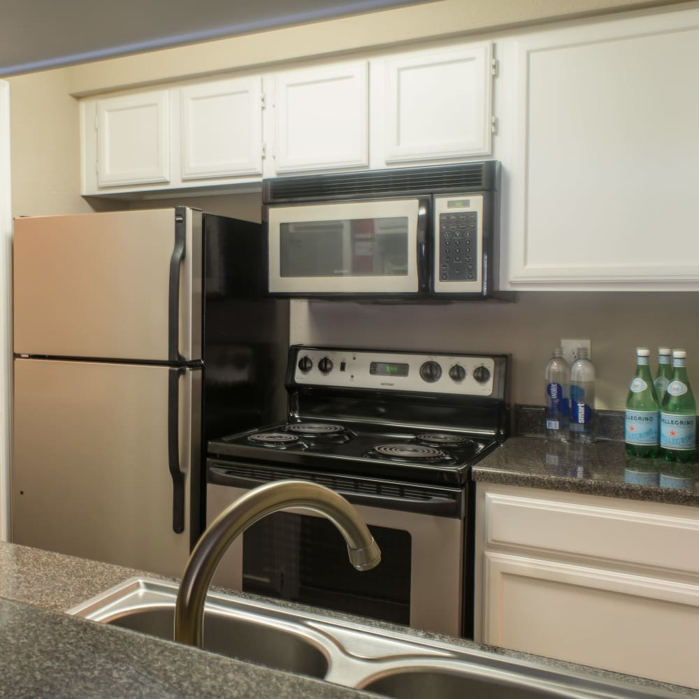 Kitchen with stainless steel appliances at Hayden at Enclave in Houston, Texas