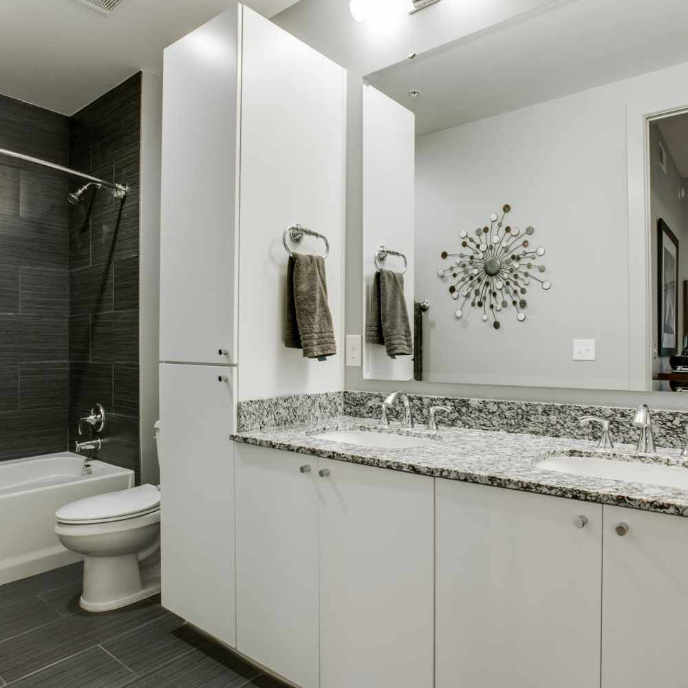 Modern bathroom with granite countertops at Cantabria at Turtle Creek in Dallas, Texas