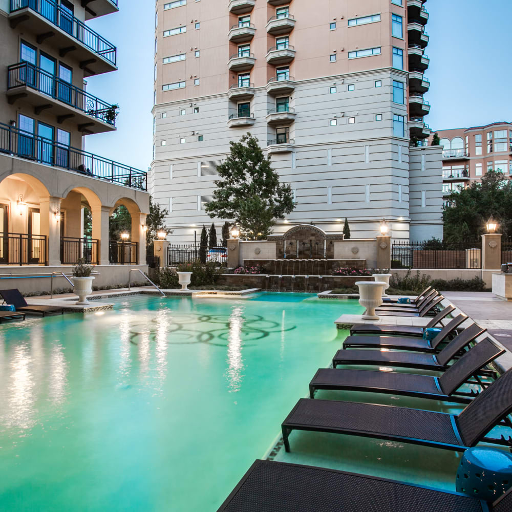 Resort-style swimming pool with lounge chairs at Cantabria at Turtle Creek in Dallas, Texas