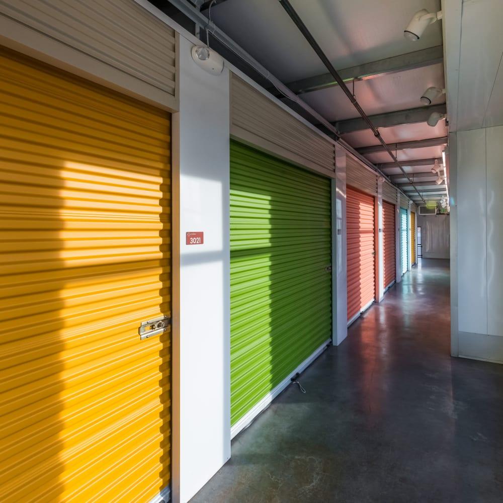 Row of interior storage units at Cubes Self Storage in Farmington, Utah