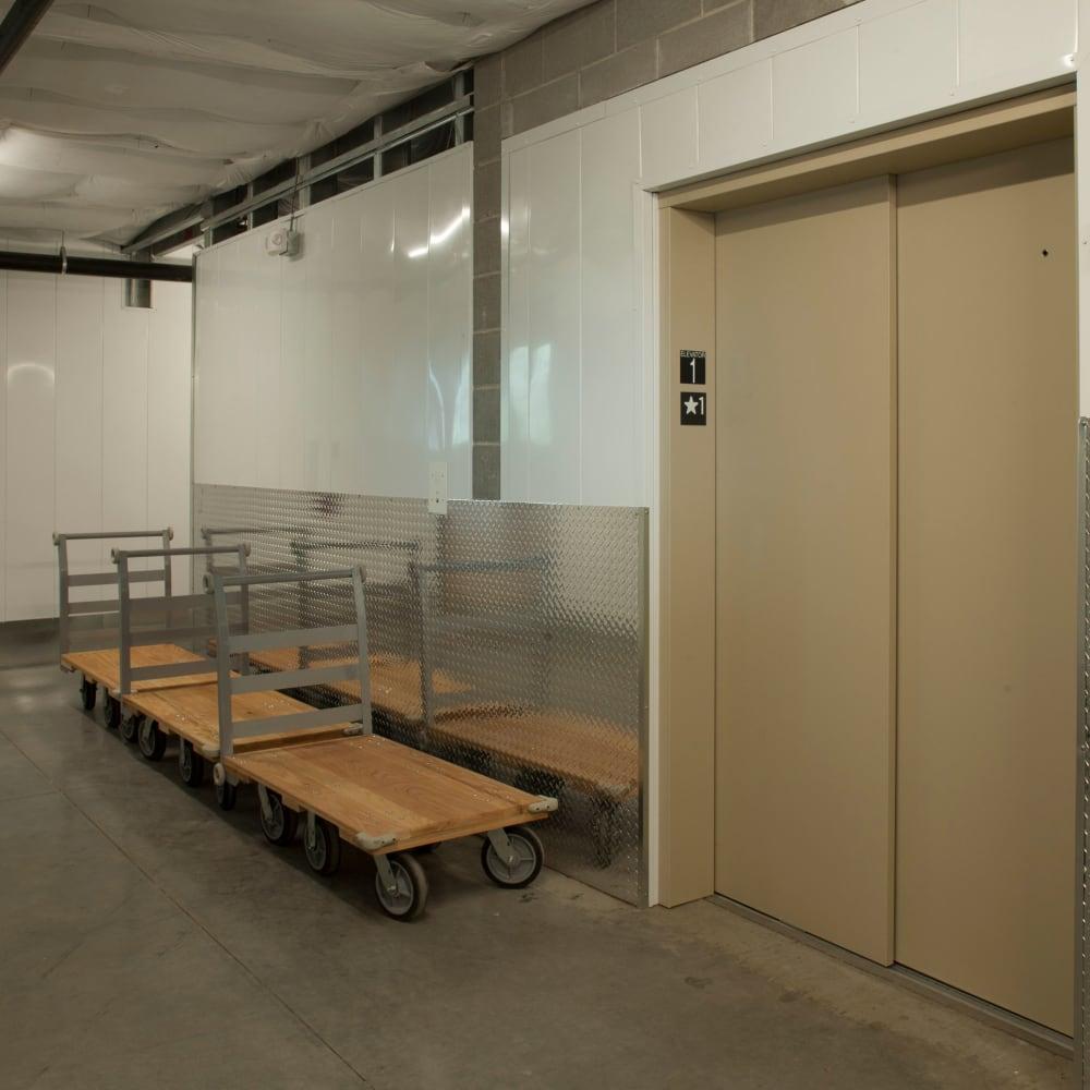 Elevator and moving carts at Cubes Self Storage in Farmington, Utah