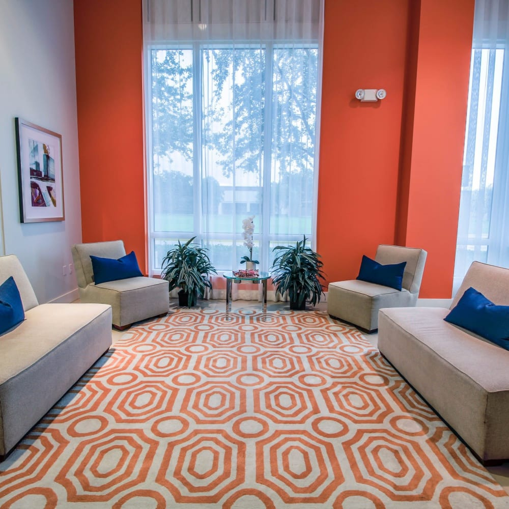Resident lounge area with orange accents at Midtown 24 in Plantation, Florida