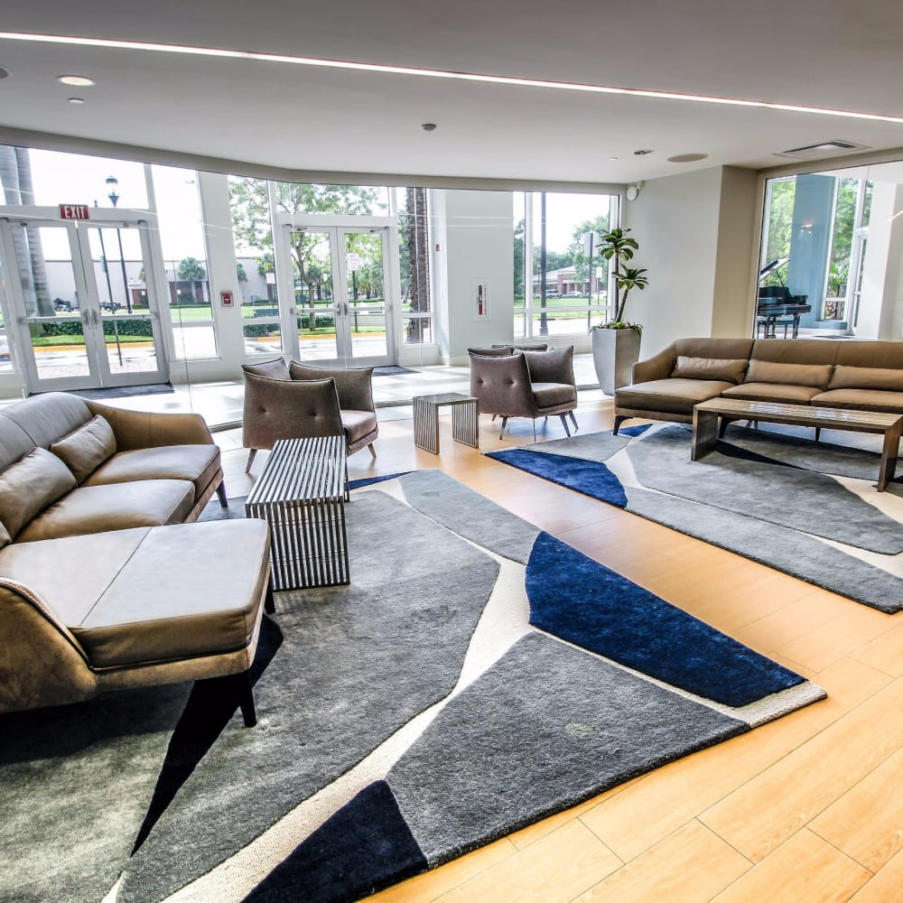Modern lobby with plenty of couches for entertaining guests at Midtown 24 in Plantation, Florida