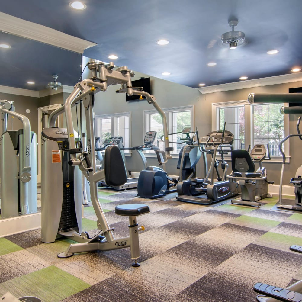 Fitness center with individual workout stations at Cavalier @ 100 in Lithonia, Georgia