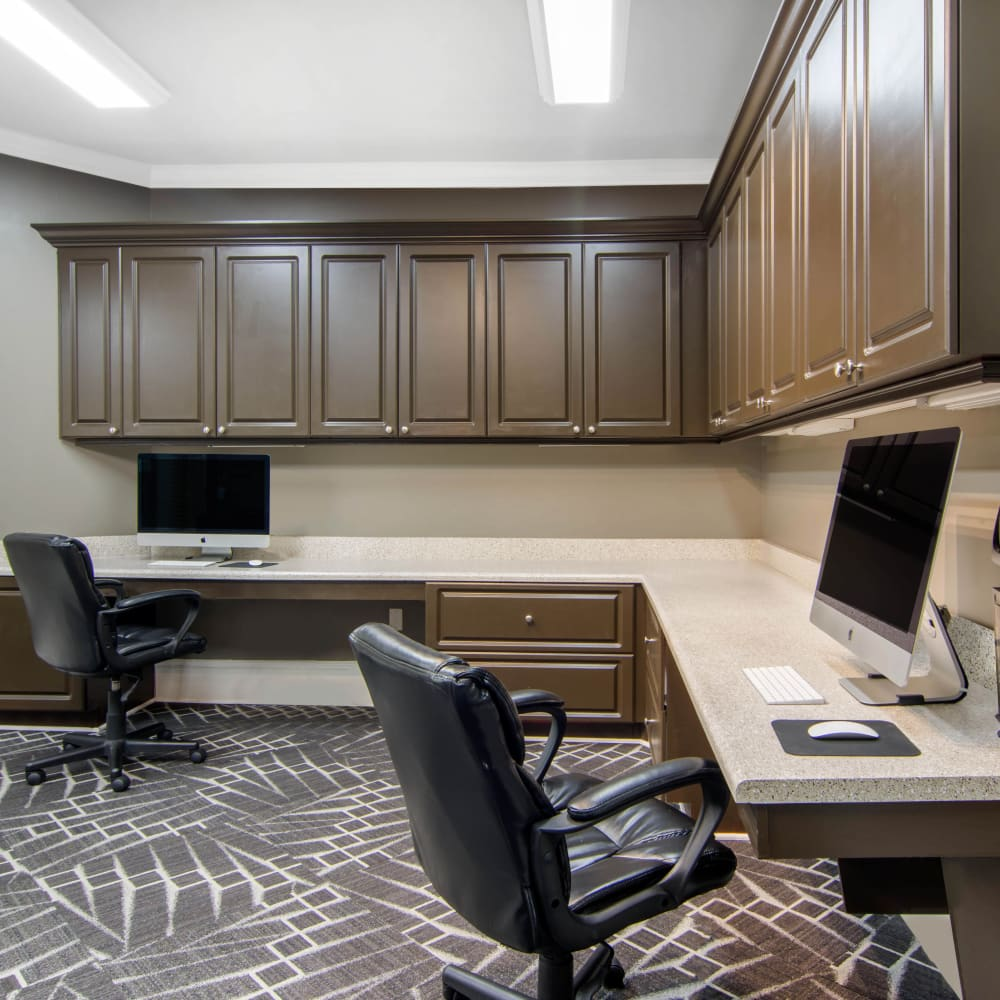 Business center with personal desktops for resident use at Cavalier @ 100 in Lithonia, Georgia