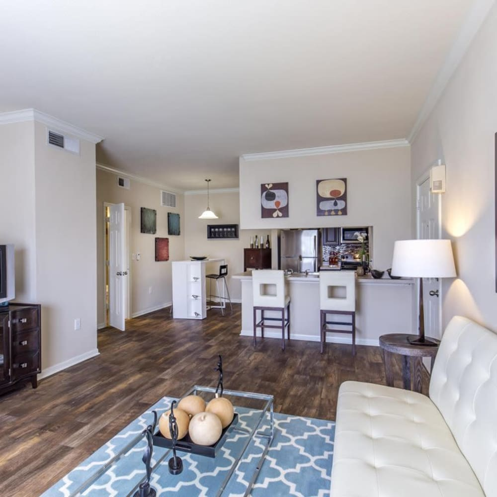 Open-concept floor plans with wood-style flooring at Ranch at Hudson Xing in McKinney, Texas