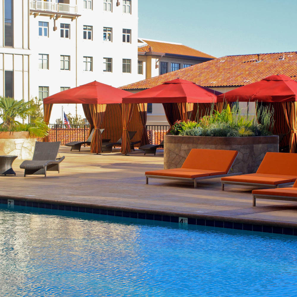 Pool with patio seating at Hillsborough Plaza Apartments in San Mateo, California