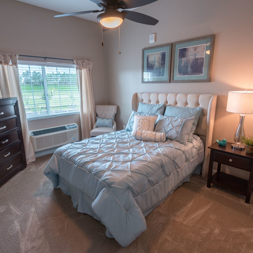 Residents bedroom inside an apartment at Inspired Living Ivy Ridge in St Petersburg, Florida