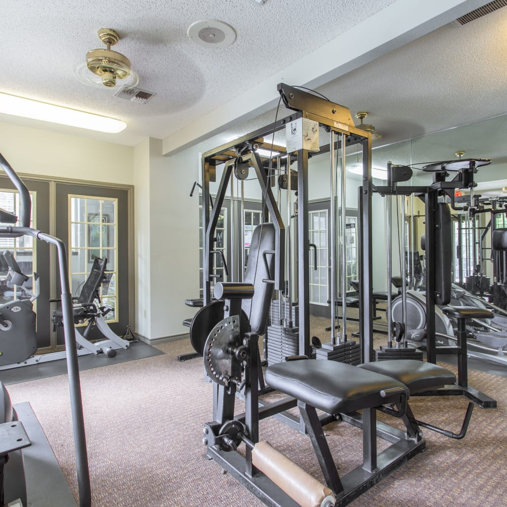 Resident fitness center with individual work stations at Canopy on Central in Bedford, Texas