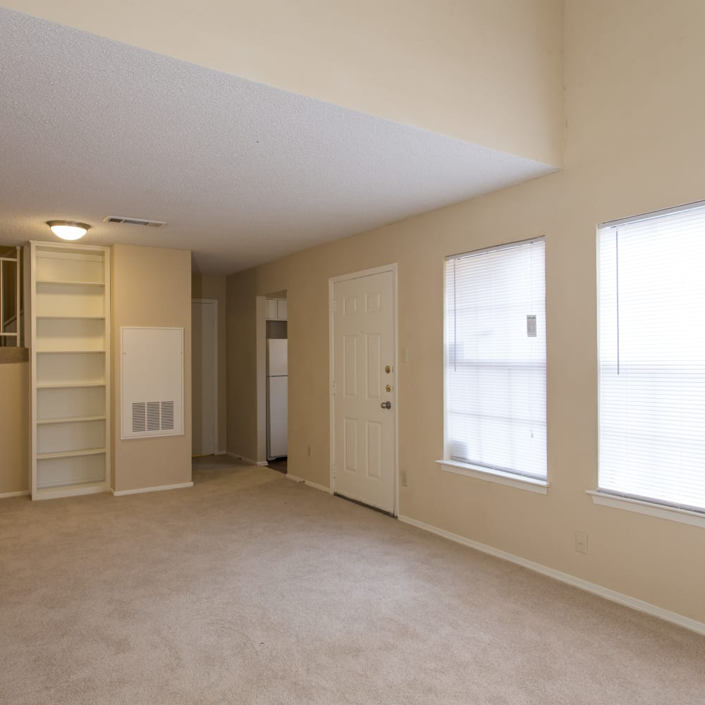 Large living room with plush carpeting at Canopy on Central in Bedford, Texas