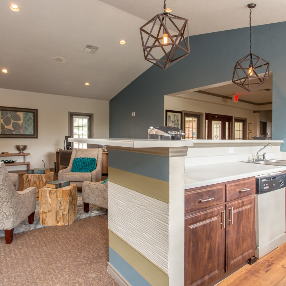 Clubhouse lounge with a community kitchen for entertaining guests at Canopy on Central in Bedford, Texas