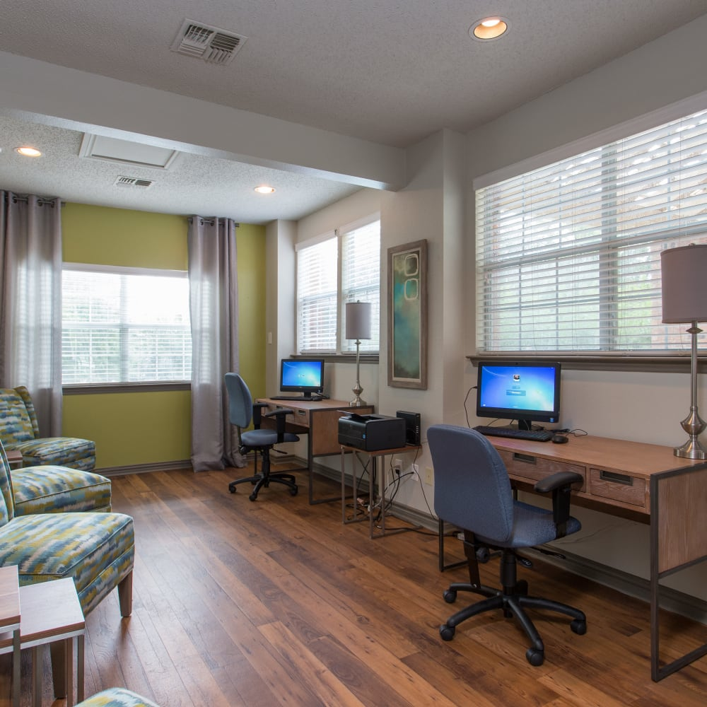 Resident business center with personal computers at Canopy on Central in Bedford, Texas