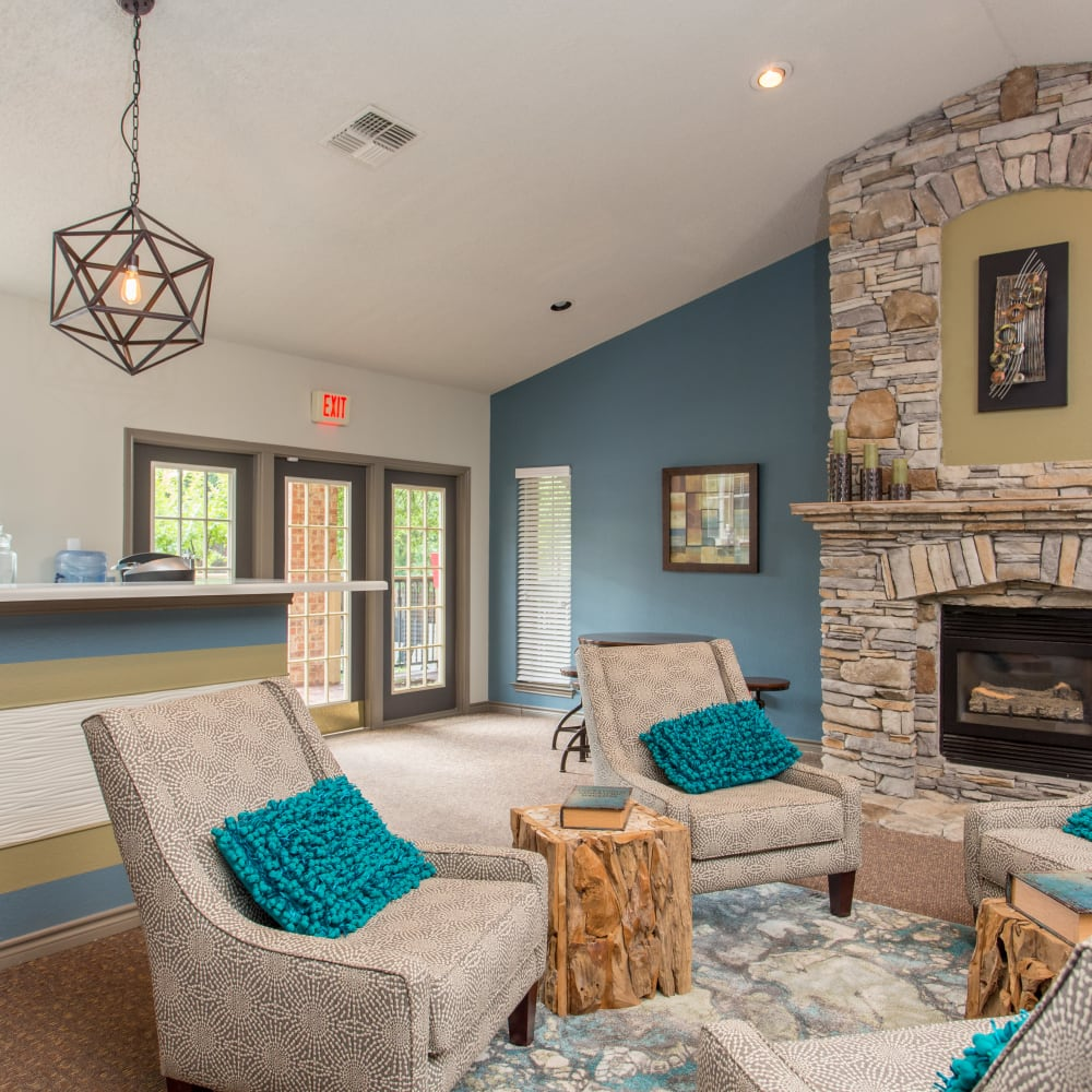 Clubhouse lounge with fireplace at Canopy on Central in Bedford, Texas