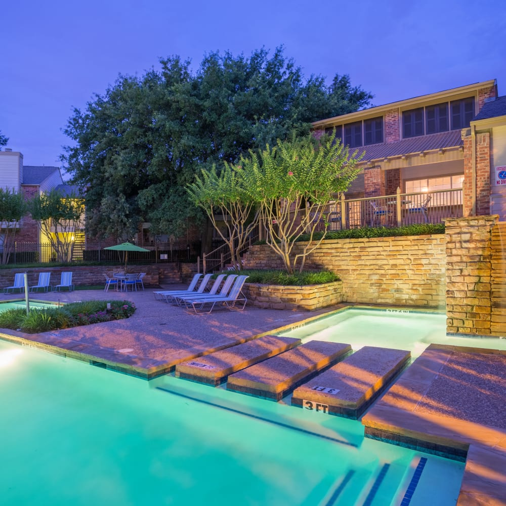Beautiful swimming pool at dusk at Canopy on Central in Bedford, Texas