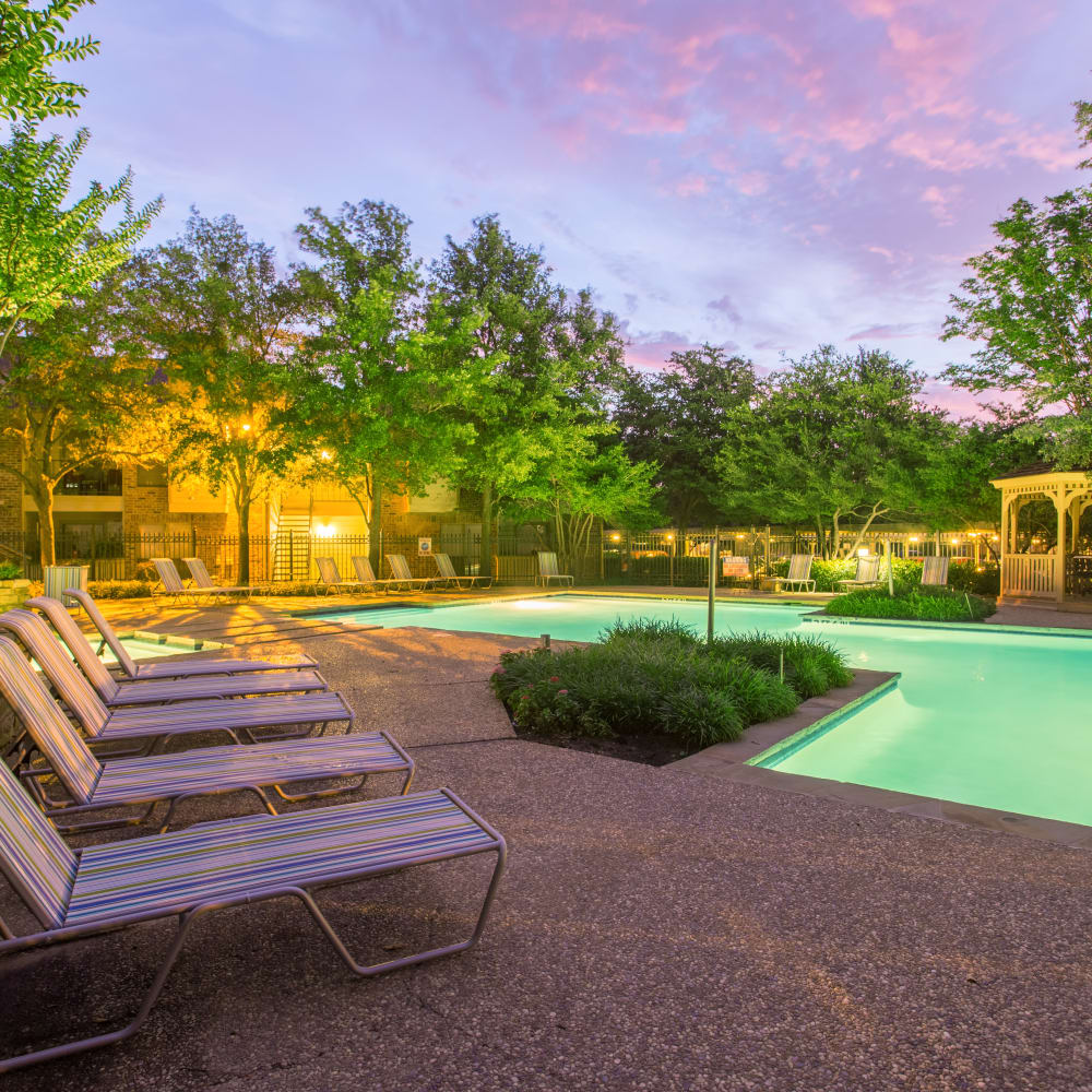 Swimming pool with deck and lounge chairs at Canopy on Central in Bedford, Texas