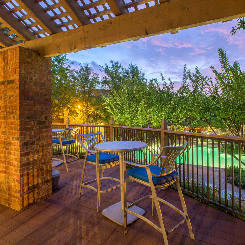Clubhouse deck with a pool view at Canopy on Central in Bedford, Texas