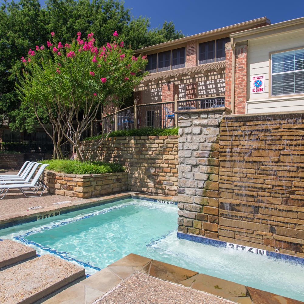 Spa with a waterfall at Canopy on Central in Bedford, Texas