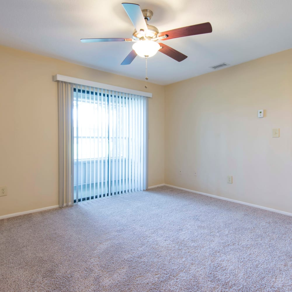 Large living room with a patio access at Compass in Melbourne, Florida