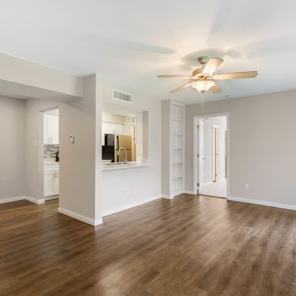 An apartment living room and kitchen at Lodge @ 1550 in Katy, Texas