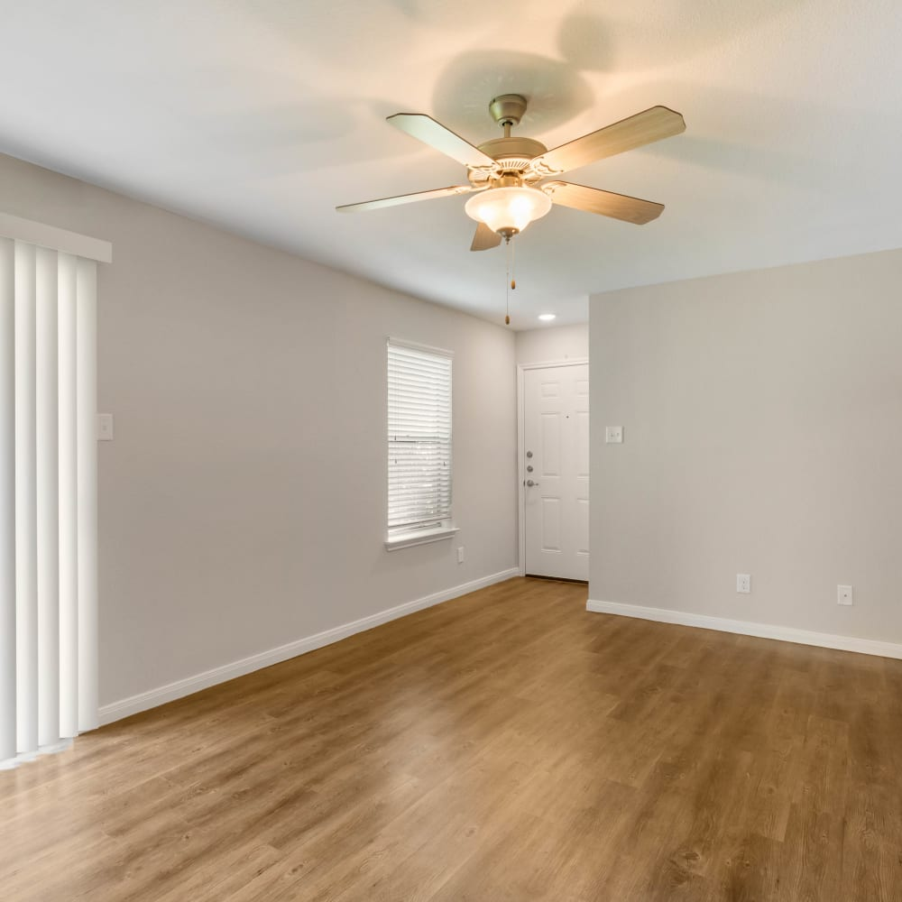 Wood flooring in an apartment living room at Lodge @ 1550 in Katy, Texas