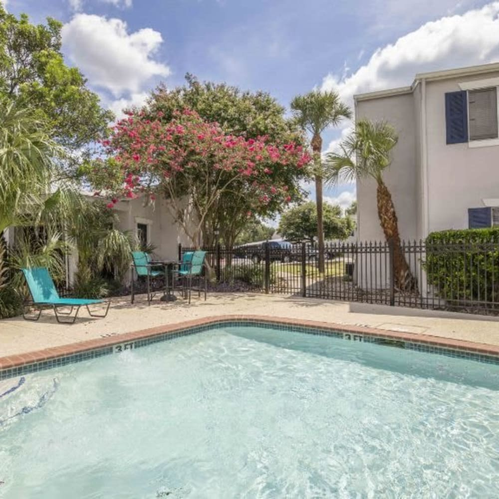 Swimming pool surround by lush vegetation at Royal Palms in San Antonio, Texas