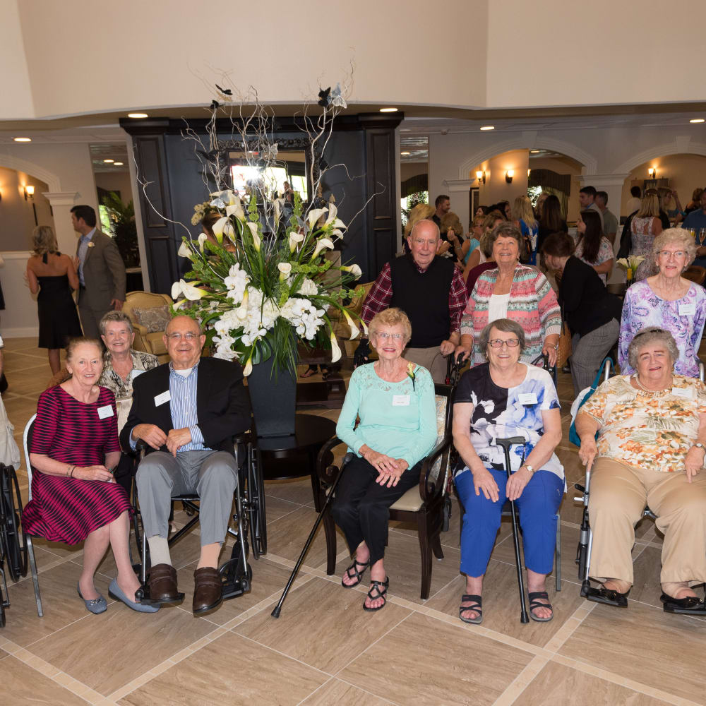 A group of residents pose for a picture at a Inspired Living community.
