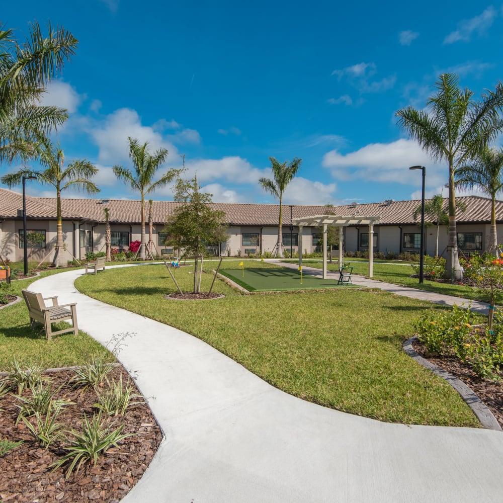 Walking paths and putting greens at Inspired Living Bonita Springs in Bonita Springs, Florida